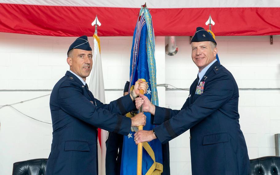 Brig. Gen. David Eaglin, right, accepts command of the 18th Wing from 5th Air Force deputy commander Maj. Gen. Leonard Kosinski at Kadena Air Base, Okinawa, Friday, July 16, 2021.