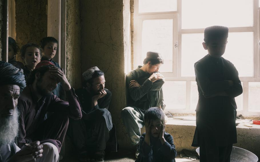 The family of Sher Mohammed, far left, was inside their home in the village of Sarmarda in April 2019 when Afghan forces raided the compound. When his son refused to come out, Mohammed said, an airstrike was called on the house. His son, his son's wife, their three children and two other relatives were killed.