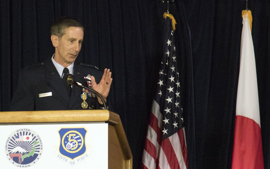 Lt. Gen. Kevin Schneider, outgoing commander for U.S. Forces Japan and 5th Air Force, speaks about threats to regional security during a change-of-command ceremony at Yokota Air Base in western Tokyo, Friday, Aug. 27, 2021.