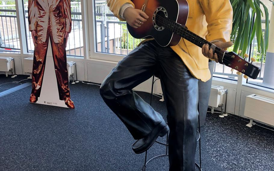 A statue and cutout of Elvis Presley in the tourist office in Bad Nauheim, Germany, Aug. 15, 2021. The spa town hosts the European Elvis Festival in August as a tribute to Presley, who lived in Bad Nauheim from 1958-1960 when he was a U.S. Army private.