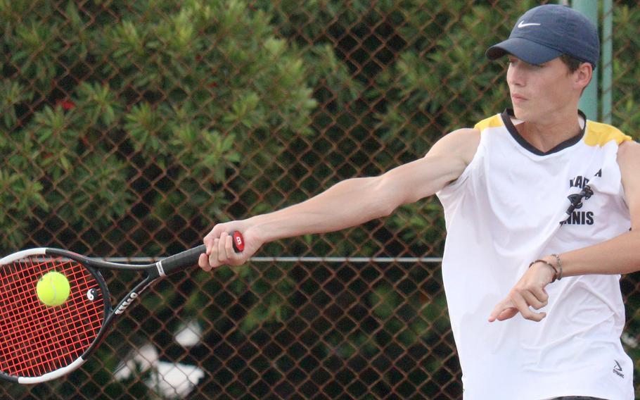 Kadena's Evan Davis hits a forehand return against Kubasaki's Owen Ruksc during Wednesday's Okinawa tennis matches. Davis won 9-8 (7-3).