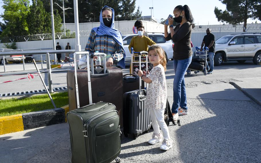 Rahima Asadi, left, her daughter Zainab, and the family's lawyer, Kimberley Motley, stand by their luggage prior to leaving Afghanistan on June 1, 2021. For six months, the Asadis hid on the outskirts of Kabul due to fears of assassination by the Taliban and retribution from the Afghan government for wanting to leave the country.