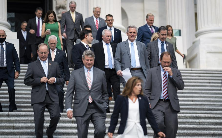 House Minority Leader Kevin McCarthy, R-Calif., walks out with other Republican members to speak about the leadership of Speaker of the House Nancy Pelosi, D-Calif., and President Biden from the House steps on Capitol Hill on July 29, 2021 in Washington.
