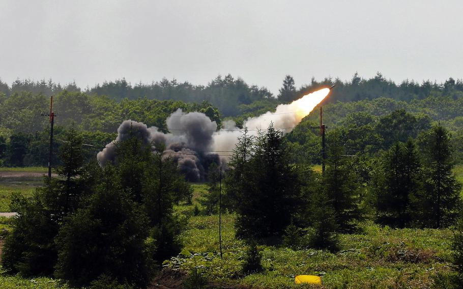 American soldiers fire a High Mobility Artillery Rocket System on the Japanese island of Hokkaido during a large-scale exercise that concluded Wednesday, July 7, 2021.