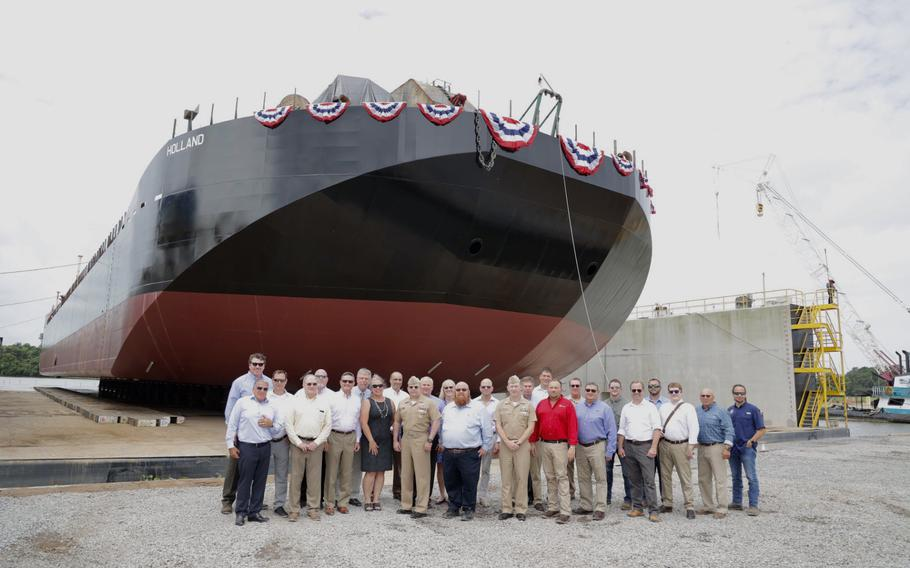 U.S. Navy, Bollinger Shipyards, General Dynamics Electric Boat and Bristol Harbor Group representatives in front of the Holland.