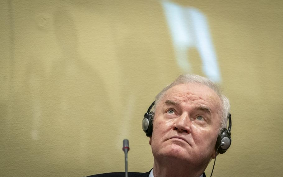 Former Bosnian Serb military chief Ratko Mladic sits in the court room in The Hague, Netherlands, Tuesday, June 8, 2021, where the United Nations court delivers its verdict in the appeal of Mladic against his convictions for genocide and other crimes and his life sentence for masterminding atrocities throughout the Bosnian war.