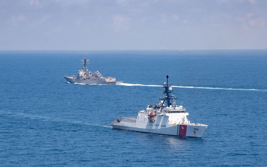 The U.S. Coast Guard cutter Monro and U.S. Navy guided-missile destroyer USS Kidd transit the Taiwan Strait, Friday, Aug. 27, 2021.