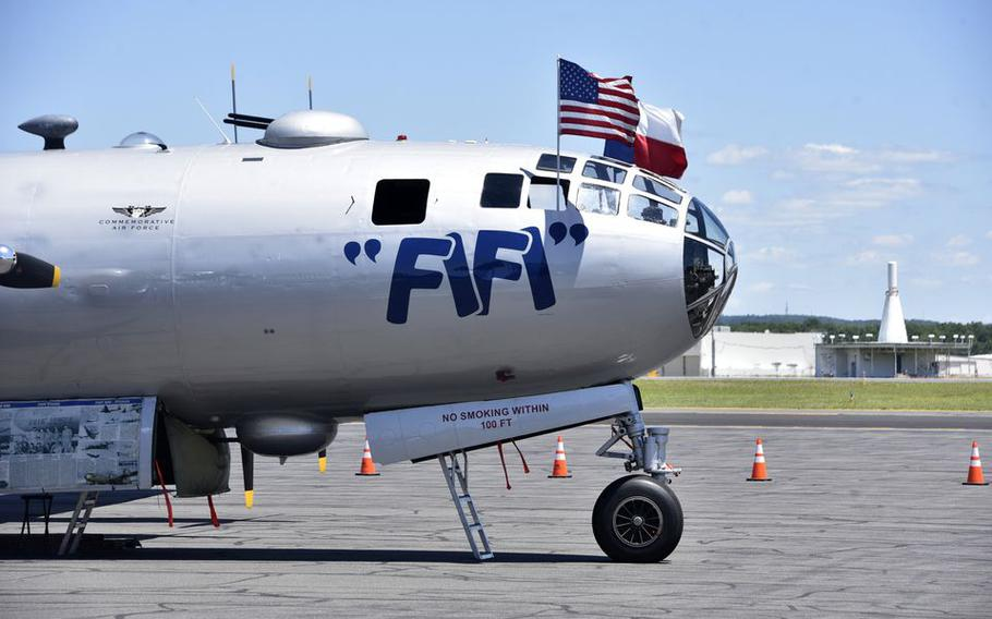 """""""Fifi,"""" a B-29 Superfortress, sits on the tarmac during the AirPower History Tour at Westfield-Barnes Regional Airport, a display by the Commemorative Air Force team."""