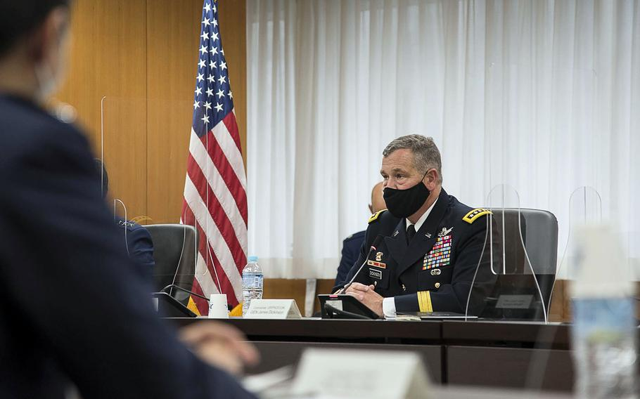Army Gen. James Dickinson, who oversees U.S. Space Command, meets with Shinji Inoue, Japan's minster of state for space policy, in Tokyo on Friday, May 21, 2021.