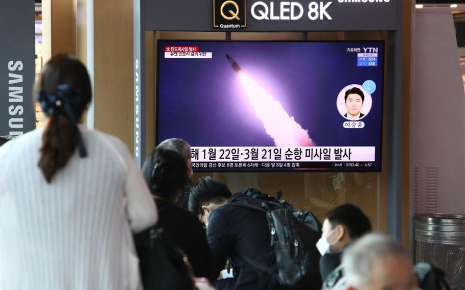 People watch a TV at the Seoul, South Korea, Railway Station on Sept. 15, 2021, showing a file image of a North Korean missile launch.