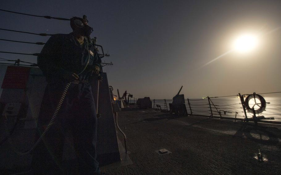 Seaman Aaron Henry monitors the horizon for surface and air contacts during watch onboard the guided missile destroyer USS Sterett in the Gulf of Oman in September 2020. A recent U.S. Government Accountability Office report says despite a 2017 Navy policy aimed at managing fatigue, the Navy has inconsistently implemented the policy and most officers are not getting adequate sleep.