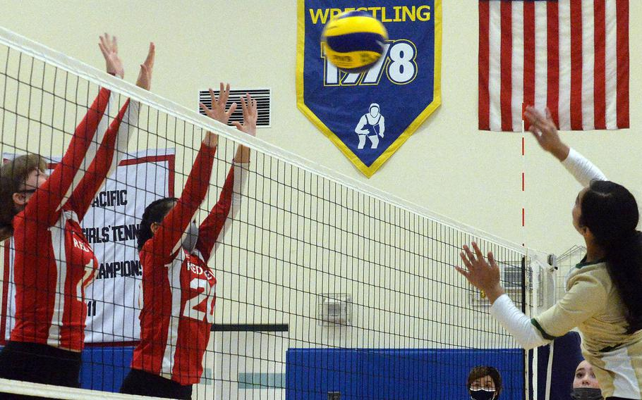 Robert D. Edgren's Annalise Tackney tries to hit through the double block of Nile C. Kinnick'sKathryn Withers and Jenia Viles during Saturday's Japan girls volleyball match. The Eagles won in straight sets, improving to 10-0 on the season without dropping a set.
