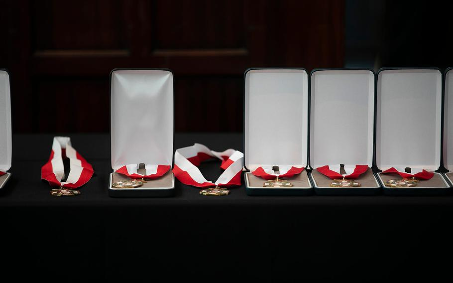 Medals wait for their recipients Friday at the induction ceremony for the Ohio Military Hall of Fame for Valor class of 2021.