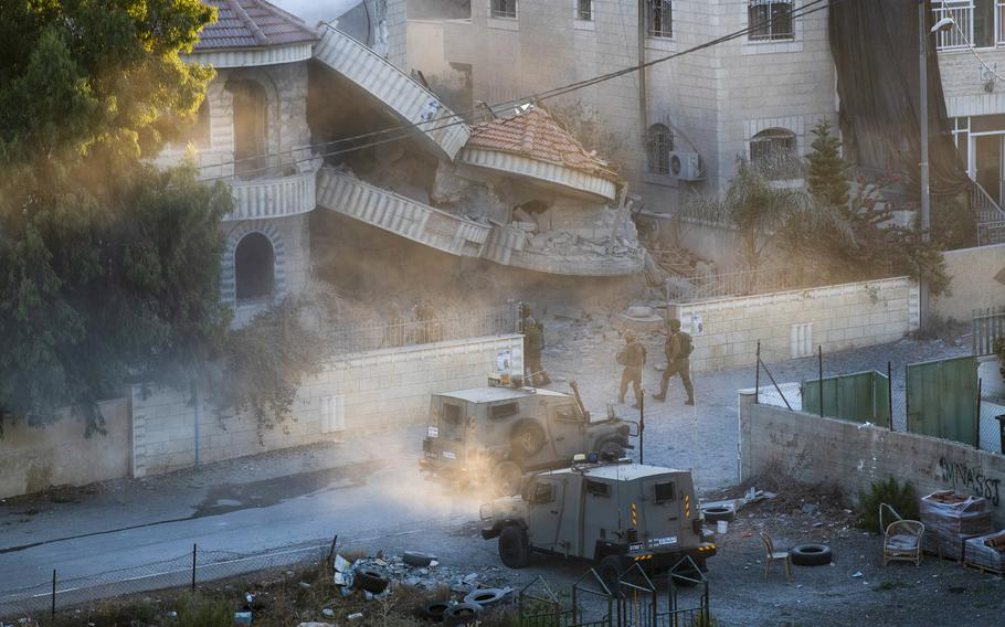 An Israeli army unit inspects the house of the Palestinian American Muntasser Shalaby following controlled explosions, in the West Bank village of Turmus Ayya, north of Ramallah, Thursday, July. 8, 2021.