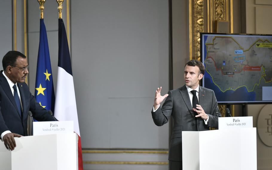 French President Emmanuel Macron, right, and Niger's President Mohamed Bazoum hold a press conference after a video summit with leaders of G5 Sahel countries at the Elysee presidential Palace in Paris, Friday July 9, 2021.