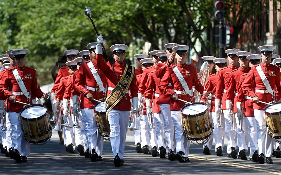 The United States Marine Drum and Bugle Corps marches as spectators enjoy the Barracks Row Parade celebrating Independence Day in Washington, D.C., on July 4, 2021.