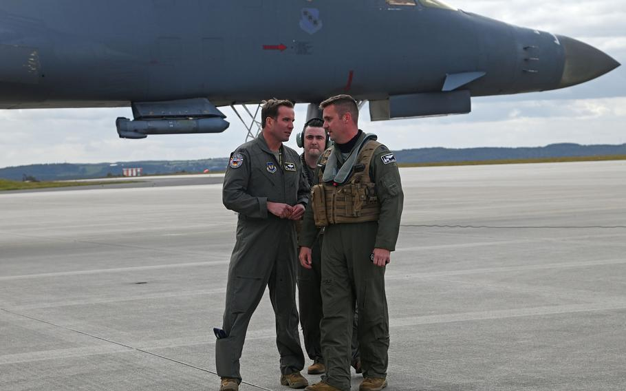 Col. Leslie Hauck, commander of the 52nd Fighter Wing at Spangdahlem Air Base, Germany, left, talks with B-1B Lancer crew members from the 9th Expeditionary Bomb Squadron after they landed at the base, Oct. 11, 2021.
