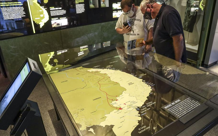 Two visitors to the National Museum of the United States Army look at a map of Vietnam on June 14, 2021.