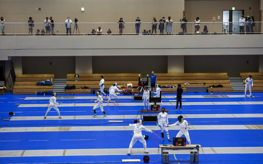 A handful of spectators watch as members of the U.S. women's Olympic fencing team practice inside the Lotus Culture Center Arena, part of the Atago Sports Complex, in Iwakuni, Japan, July 14, 2021.