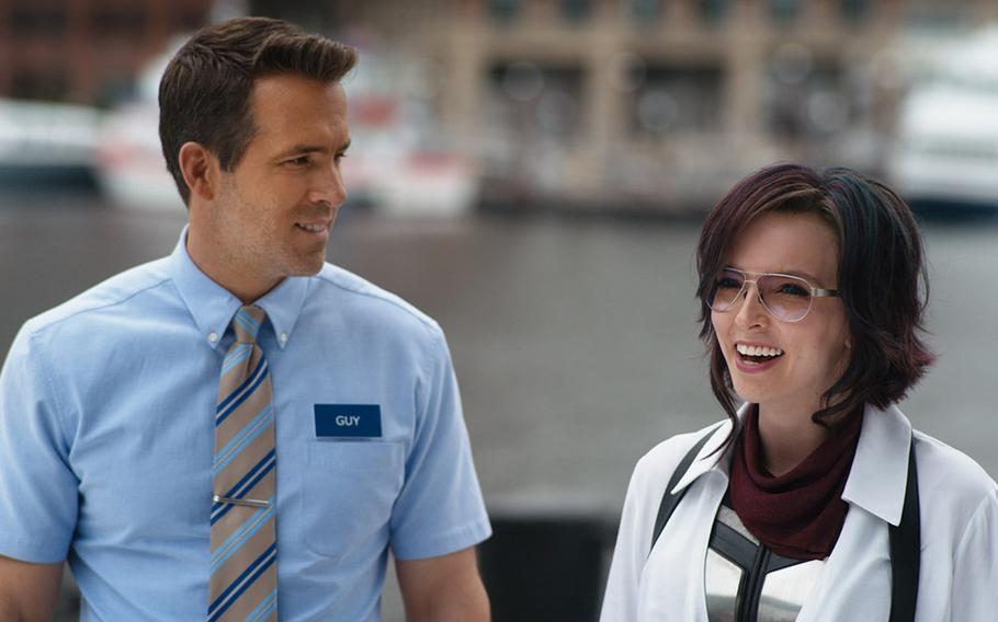 """Ryan Reynolds (left) and Jodie Comer in """"Free Guy."""""""