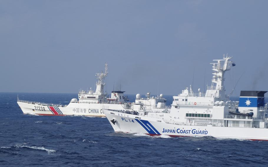 The Japan Coast Guard approaches a Chinese coast guard ship in Japanese territorial waters in this undated photo.