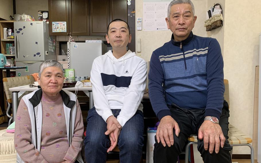 Sumiko Ohata, son Takashi and husband Masahiro in their home in Kanazawa, Japan.