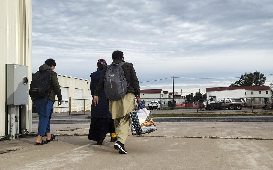 An Afghan family prepares to leave Fort McCoy, Wis., Oct. 11, 2021. The 30 evacuees who left on a bus that day were among the first 1,200 to take the next step of resettlement in America.