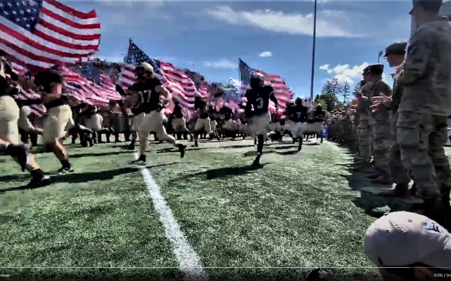 The Black Knights carry American flags onto the field at Michie Stadium ahead of their game against Western Kentucky on Saturday, Sept. 11, 2011, in West Point, N.Y.