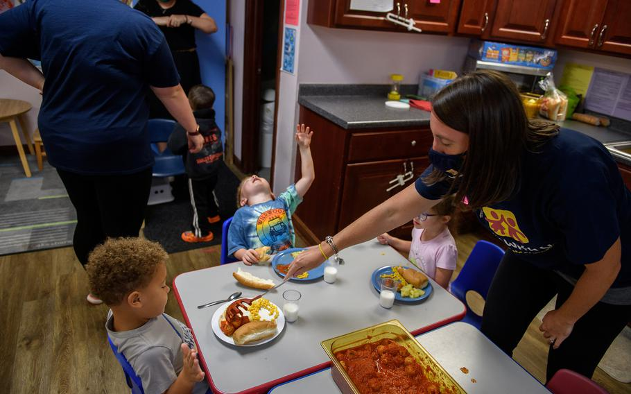 Kelly Soyka, 34, serves a meal at Begin With Us Pre-K Center in Altoona, Pa.