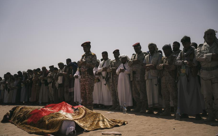 Mourners gather Aug. 18 to remember soldiers Abdo al-Kahli and Ibrahim al-Qamhi.