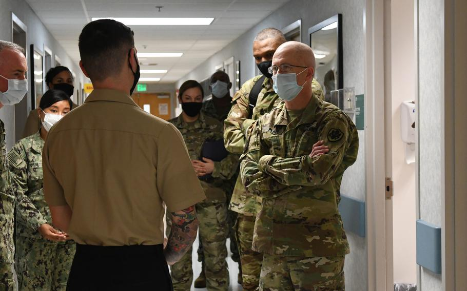 Lt. Gen. Ron Place, right, takes a tour March 22, 2021, atBHC Camp Smith, a clinic for active-duty members at Marine Corps Base Hawaii, Camp Smith. Just over 70% of active-duty troops were fully vaccinated against COVID-19 as of Sept. 8, 2021, two weeks after the vaccine became mandatory for members of the military.