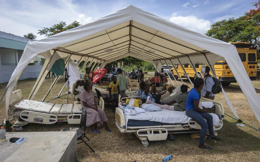 Patients of OFATMA Hospital in Les Cayes, Haiti, are being cared for in tents on Monday, Aug. 16, 2021. Though it did not collapse, the hospital's walls and floor cracked during the earthquake and no one wants to go back inside.