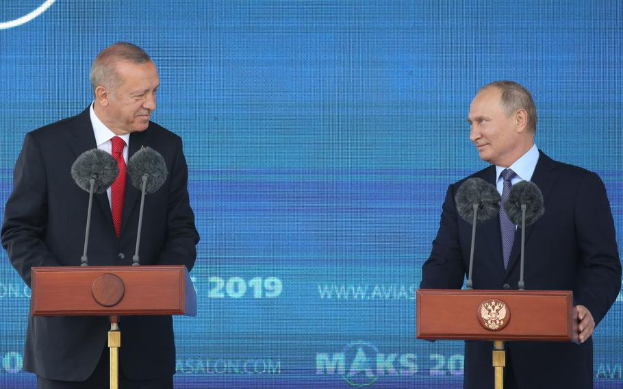 Recep Tayyip Erdogan, Turkey's president, left, and Vladimir Putin, Russia's president, at a news conference in Moscow on Aug. 27, 2019.