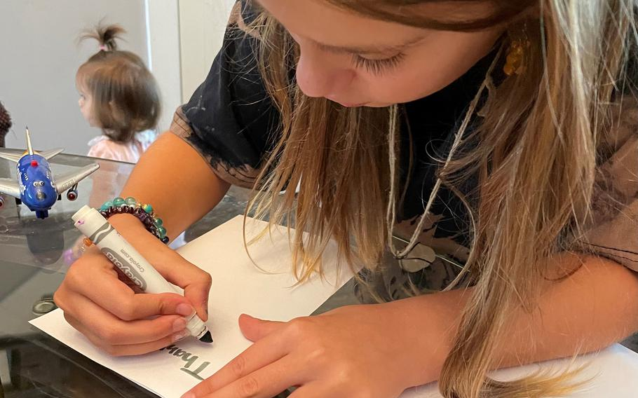 Valentina Carmona, 9, making cards at her home less than two miles from Surfside. She and her family know many of the residents at Champlain Towers South.
