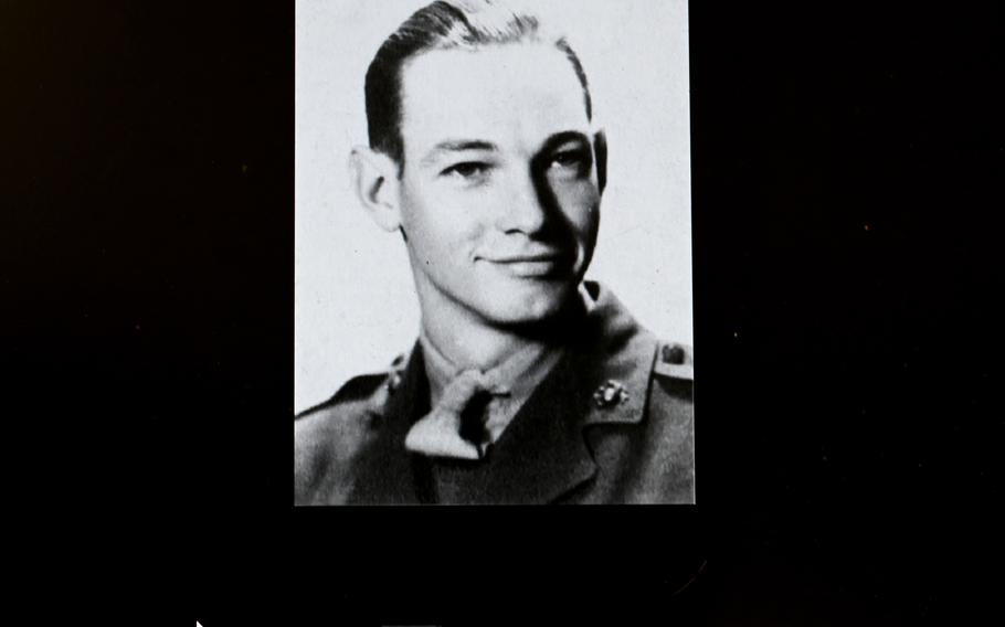 A photograph of Marine Clarence Hodgson of Iowa is viewed on a computer monitor at the National Museum of the Marine Corps.