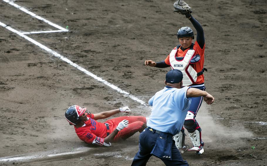 Michelle Moultrie, an outfielder for the U.S. Women's Olympic softball team, slides into home plate during an exhibition game against the Hitachi Sundivas in Iwakuni, Japan, Monday, July 12, 2021.
