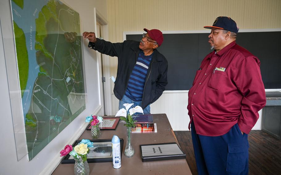 Newell Quinton, left, and Rudolph Eugene Stanley look at a map of San Domingo in the former Rosenwald School building. The cousins collaborated on a project to pinpoint the sites of more than 200 past and present homes.