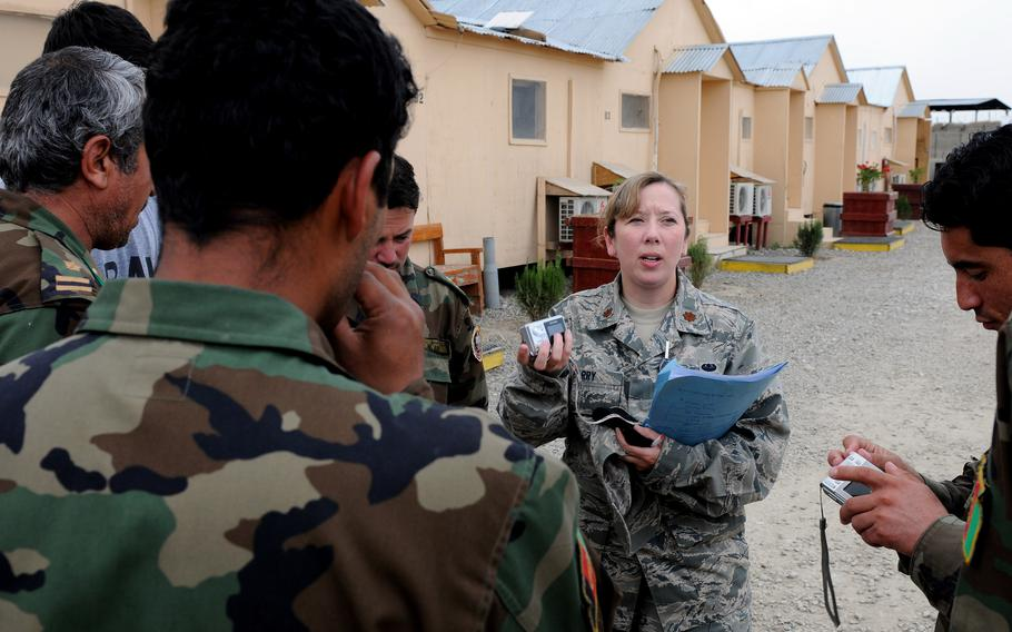 U.S. Air Force Maj. Christy Barry speaks Dari with Afghan national army officers in 2009 at the Counter Insurgency Training Academy on Camp Julien, Afghanistan, while with the Afghanistan-Pakistan Hands program. Barry said she feels anxiety as she reads the news about Afghanistan and worries about her Afghan friends and coworkers.