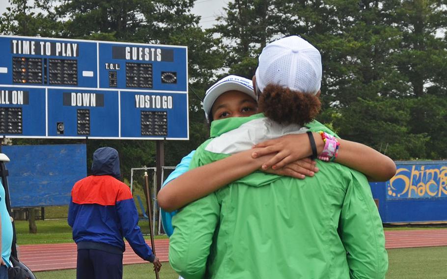 Yokota High School student Daisy Elliott embraces here mother, Cynthia Elliott, during the Kanto Plains Special Olympics at Yokota Air Base, Japan, Saturday, May 22, 2021.