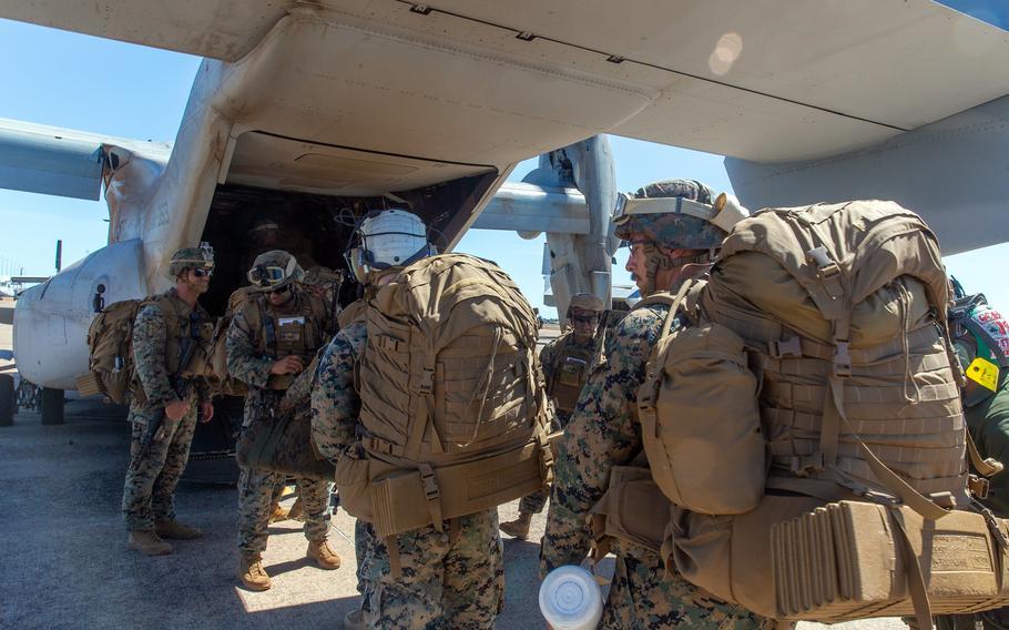 U.S. Marines board an MV-22B Osprey at Royal Australian Air Force Base Darwin, Australia, May 26, 2021.