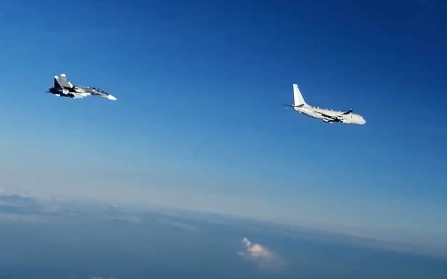 In this screenshot from a Russian Defense Ministry Facebook post, a Russian Su-30SM fighter follows a U.S. Navy P-8 Poseidon over the Black Sea, July 6, 2021, during NATO's Sea Breeze exercise.