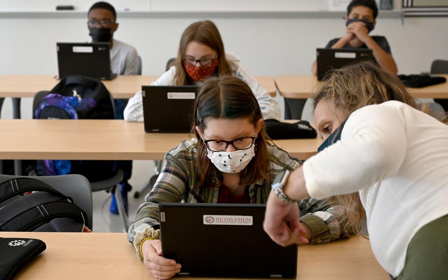 Eighth-grade English teacher Sara Pogue helps Edie Rittle during class at Nitschmann Middle School in Bethlehem, Pa.
