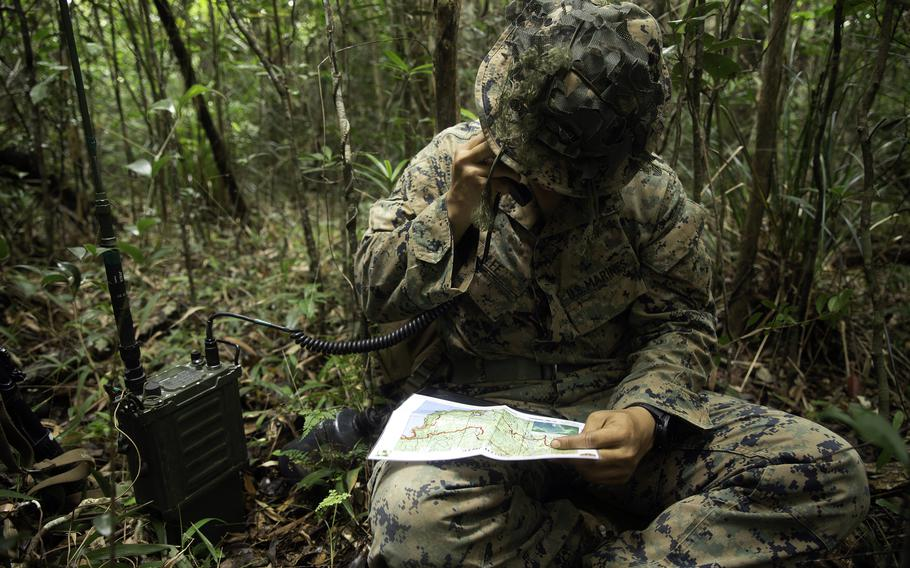 1st Lt. Eunwon Lee, the fire support team leader with 3rd Battalion, 3rd Marine Regiment, calls for fire support during a jungle warfare exercise at Okinawa's Northern Training Area, May 26, 2021.