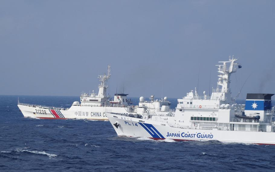 The Japan Coast Guard responds to a Chinese vessel near the Senkaku Islands in the East China Sea, in this undated photo.
