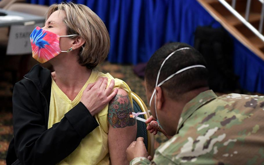 A Department of Defense Education Activity teacher receives a COVID-19 vaccine this spring at Osan Air Base, South Korea.