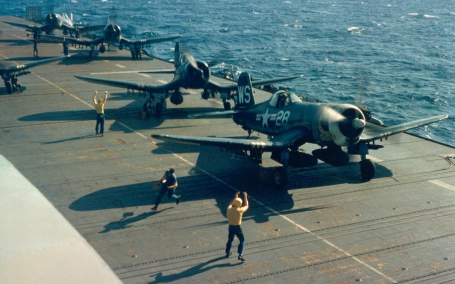 """U.S. Marine Corps Vought F4U-4Corsairs of Marine Fighter Squadron VMF-323 armed with bombs, napalm tanks and HVAR rockets are launched for a mission from the flight deck of the escort carrier USSSicily(CVE-118) off Korea, in 1951. Note the rattlesnakes painted on some aircraft, due to the squadron's nickname """"Death Rattlers."""""""