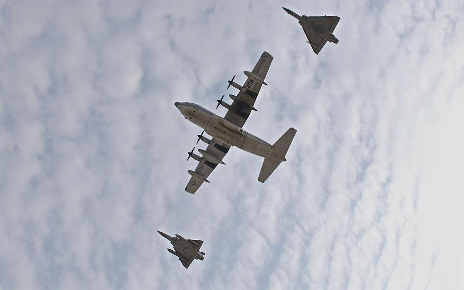 A U.S. KC-130J Super Hercules, with Combined Joint Task Force — Horn of Africa, and two French Dassault Mirage 2000s perform a combined flyover with during a Patriot's Day ceremony at Camp Lemonnier, Djibouti, Sept. 11, 2021, commemorating the 20th anniversary of 9/11.