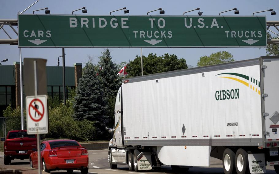 In this Friday June 15, 2012 file photo, Motorists make their way to Ambassador Bridge connecting Canada to the United States in Windsor, Ontario. The U.S. will reopen its land borders to nonessential travel next month, ending a 19-month freeze due to the COVID-19 pandemic as the country moves to require all international visitors to be vaccinated against the coronavirus. The new rules, to be announced Wednesday, Oct. 13, 2021 will allow fully vaccinated foreign nationals to enter the U.S. regardless of the reason for travel  (Mark Spowart/The Canadian Press via AP, File)