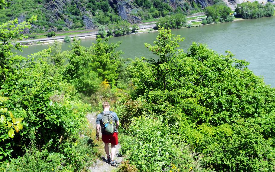 Joshua Seaman, a U.S. soldier based in Wiesbaden, Germany, hikes down part of the RheinBurgenWeg hiking trail near the town of Bad Salzig, June 5, 2021. The trail runs for 120 miles along Germany's longest river, the Rhine, passing scores of castles and other historic buildings along the way.