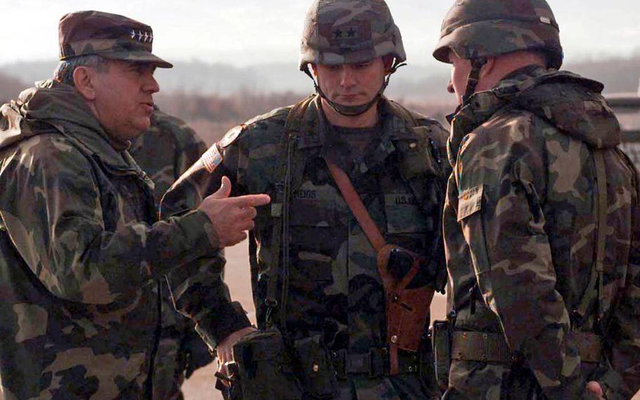 Montgomery Meigs, center, then a major general and the 1st Infantry Division commander, talks to Supreme Allied Commander Europe Gen. George Joulwan, left, and U.S. Army Europe commander Gen. William Crouch, at Tuzla Air Base in Bosnia, in 1996. Meigs was commanding Task Force Eagle at the time. Meigs died July 6, 2021, at age 76.